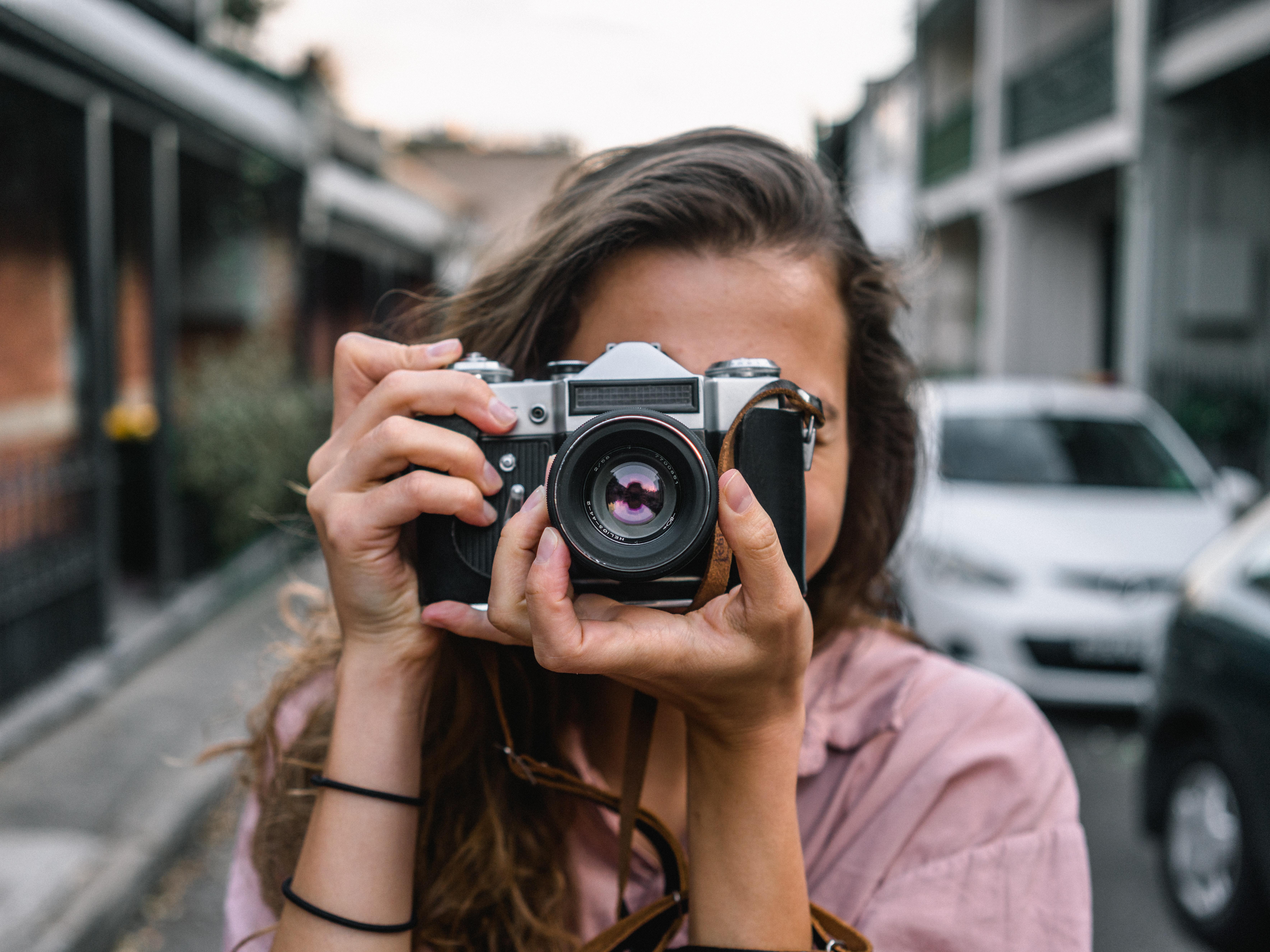 Woman shooting film camera