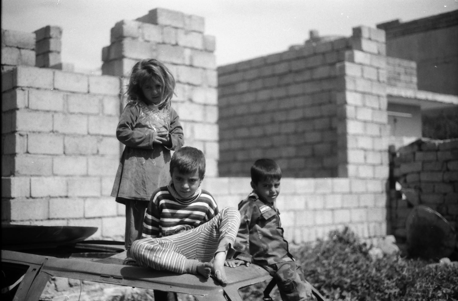 Children playing in ruined house