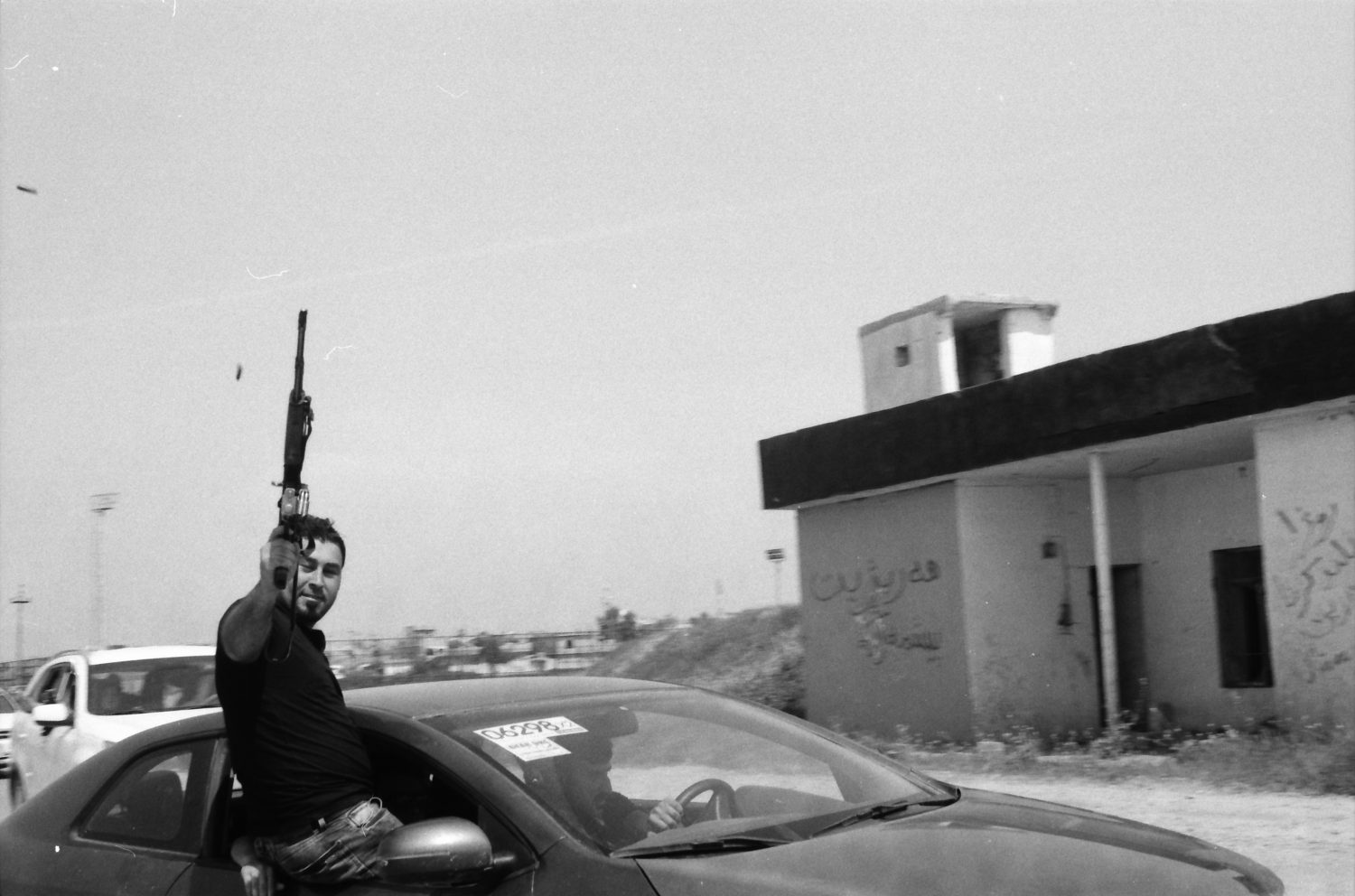 Man with gun in car