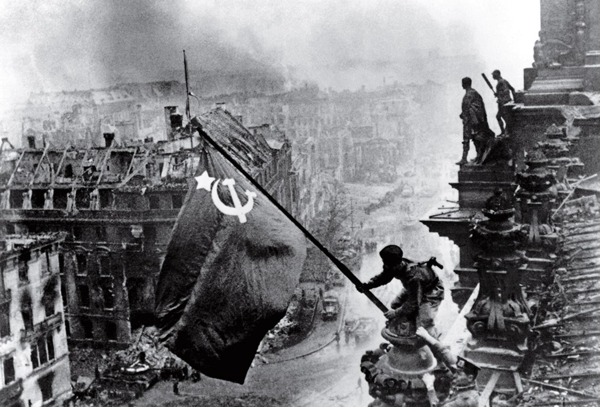 Raising the Flag over The Reichstag (Pic: Yevgeny Khaldei/TASS)