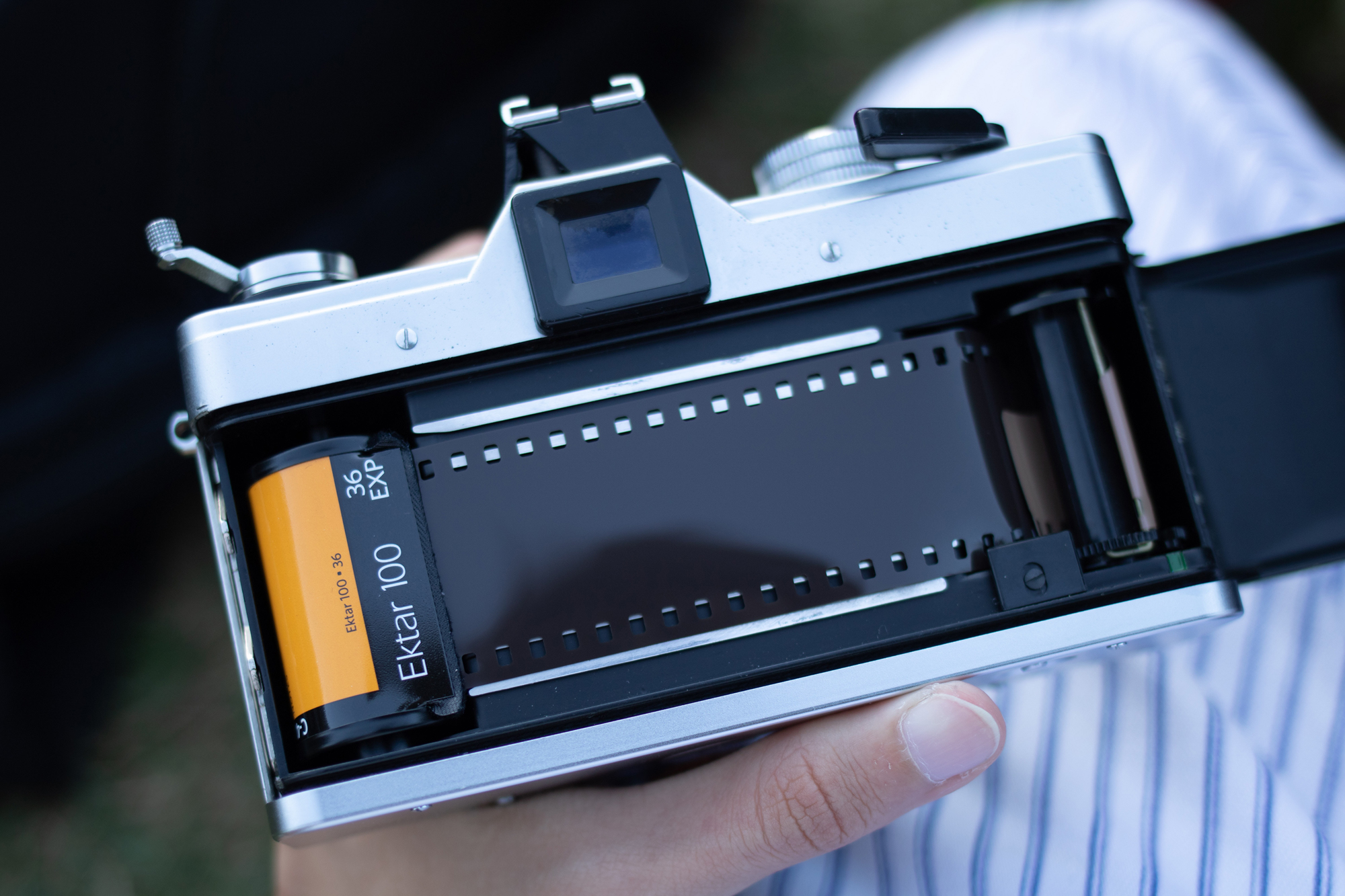 Open back of film camera with film (Pic: Athena/Pexels)