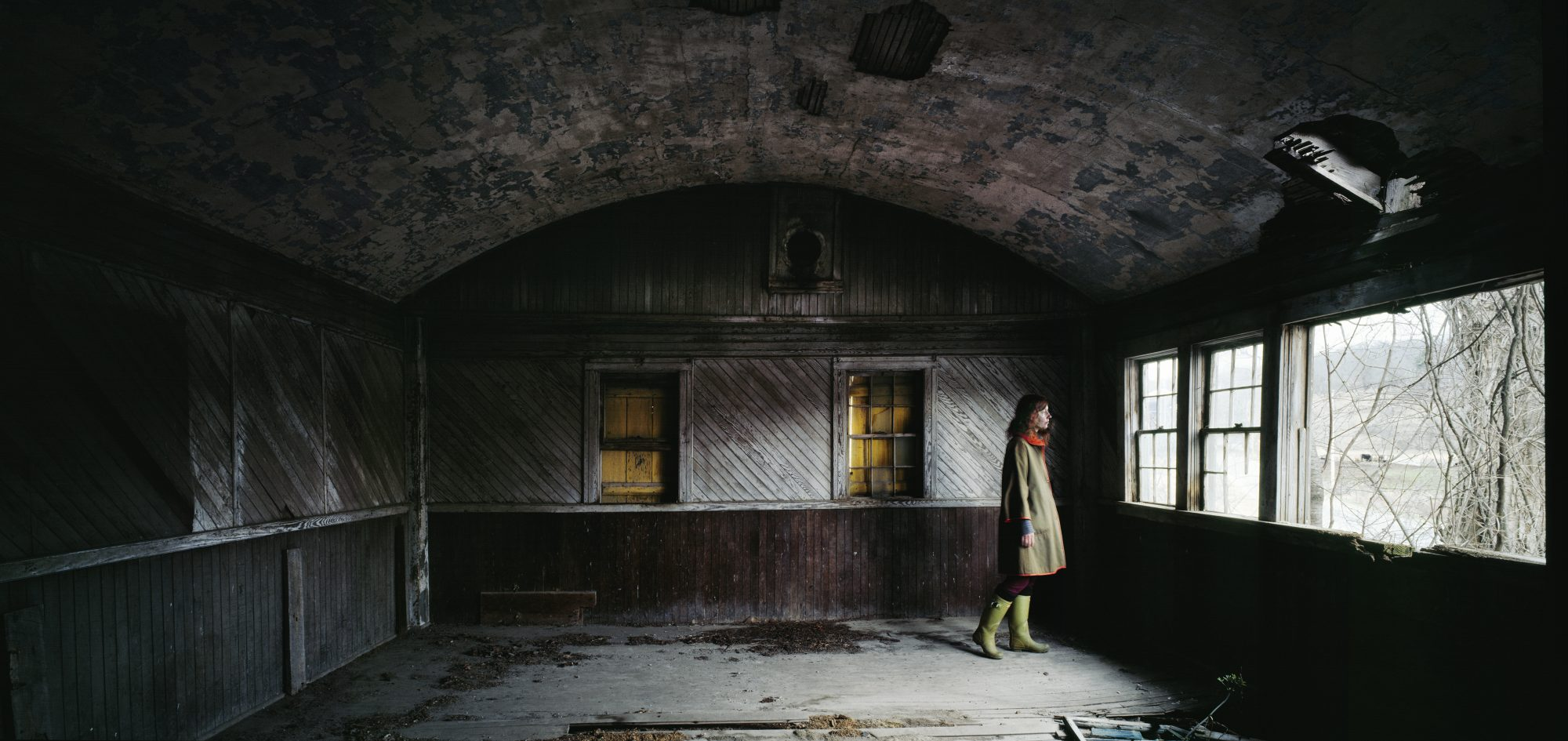 Woman in deserted building (Pic: Stephen Schaub)