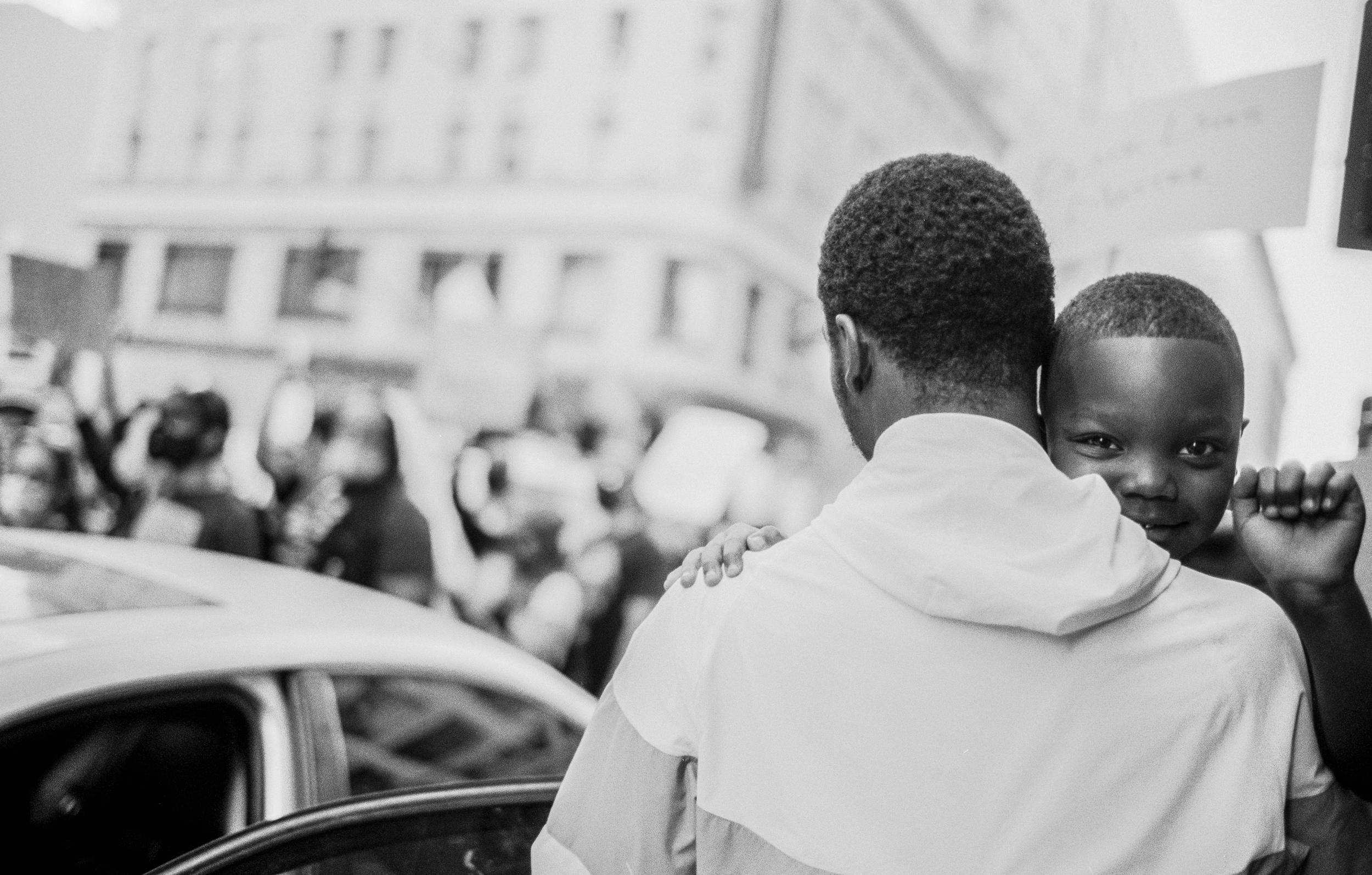 Boy looking over father's shoulder (Pic: Stephen Vanasco)