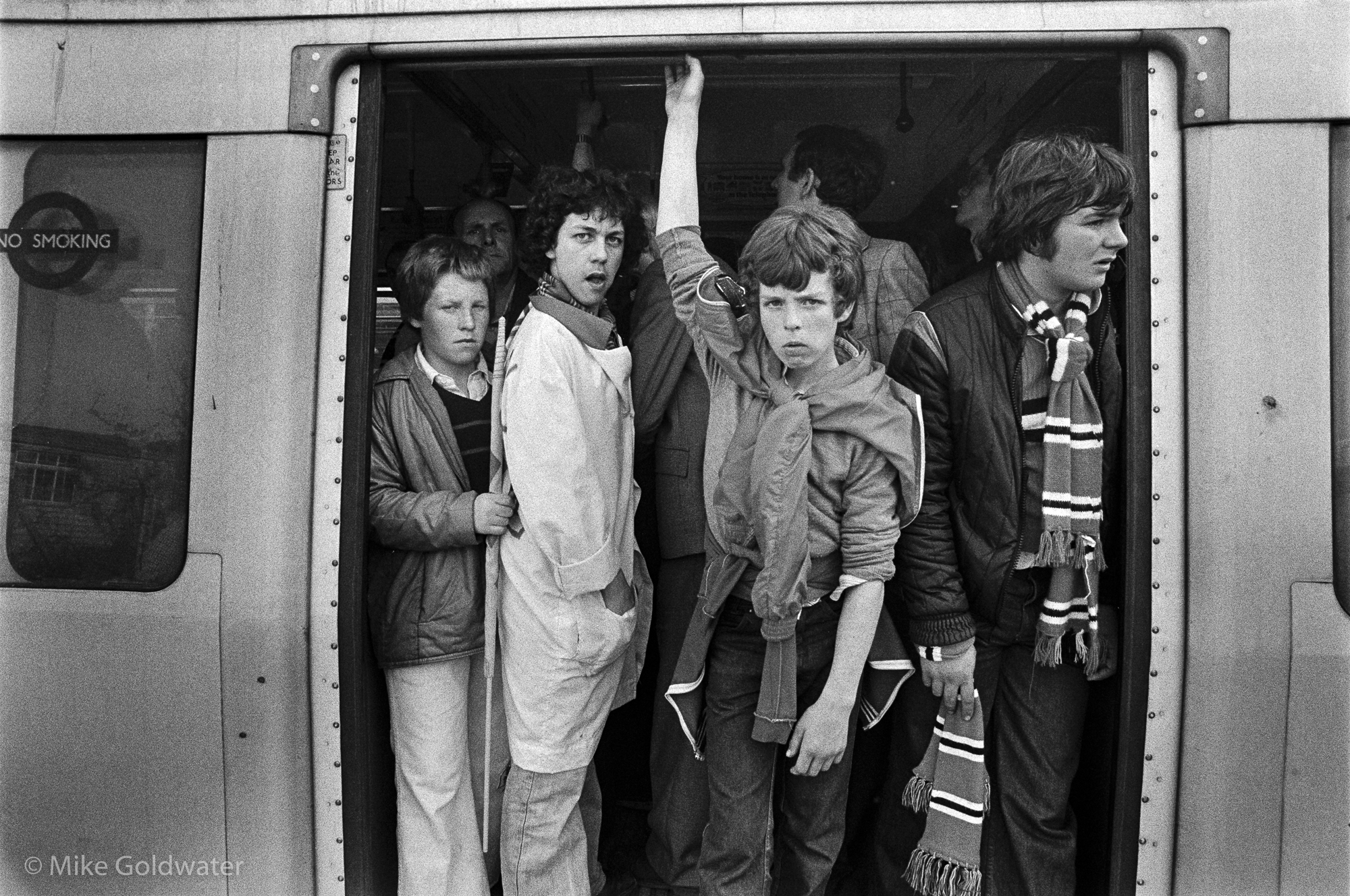 Boys in Tube doorway (Pic: Mike Goldwater)
