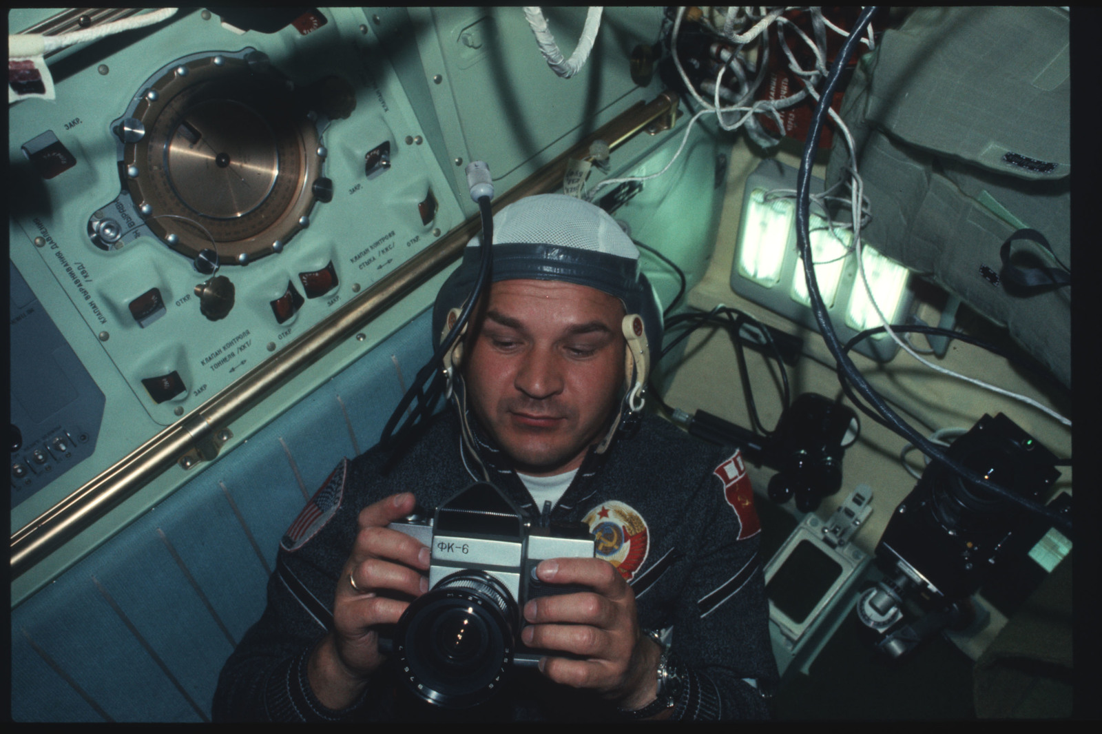 oyuz Flight Engineer Valeri Kubasov and camera