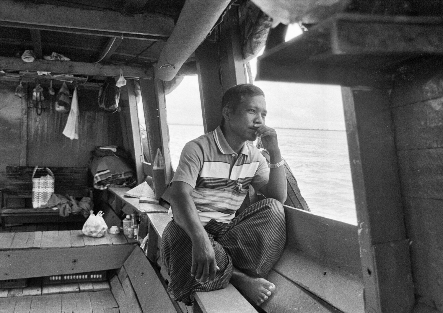 Man looking out of boat (Pic: Lester Ledesma)