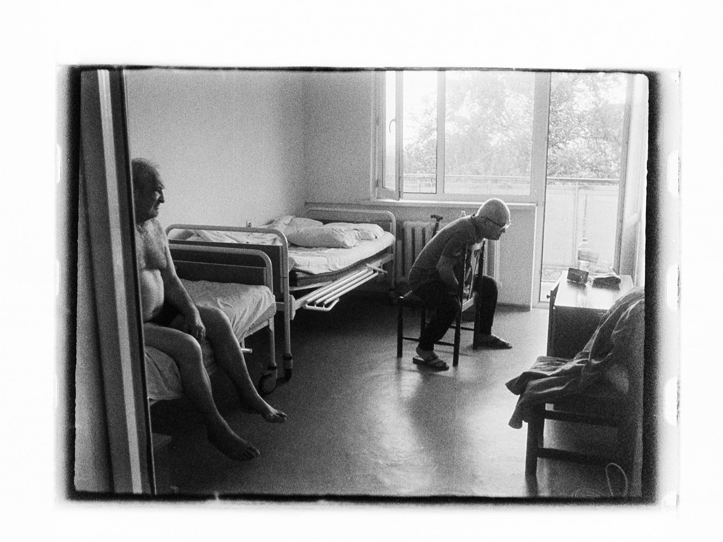 Men watching smartphone (Pic: Andrey Khludeyev)