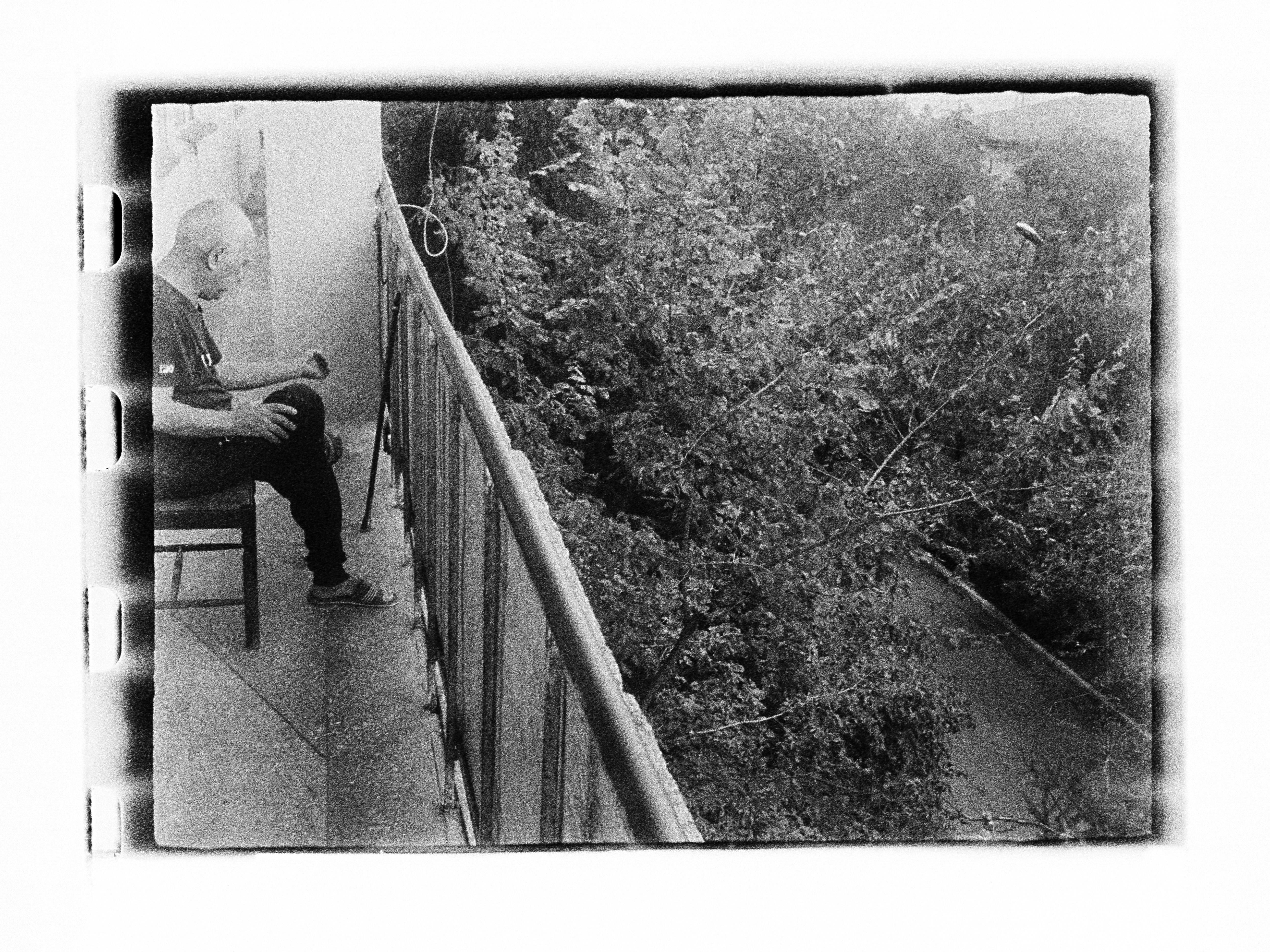 Man on balcony (Pic: Andrey Khludeyev)