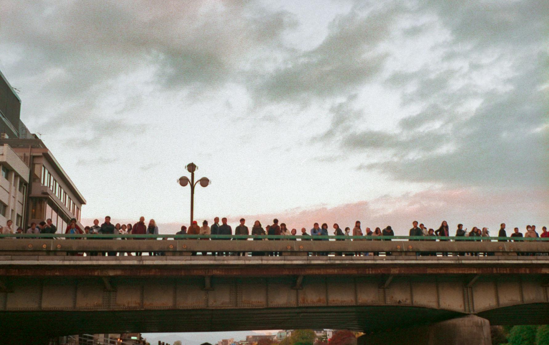 Crowd on Kyoto bridge (Pic: Luca Lo Picollo)