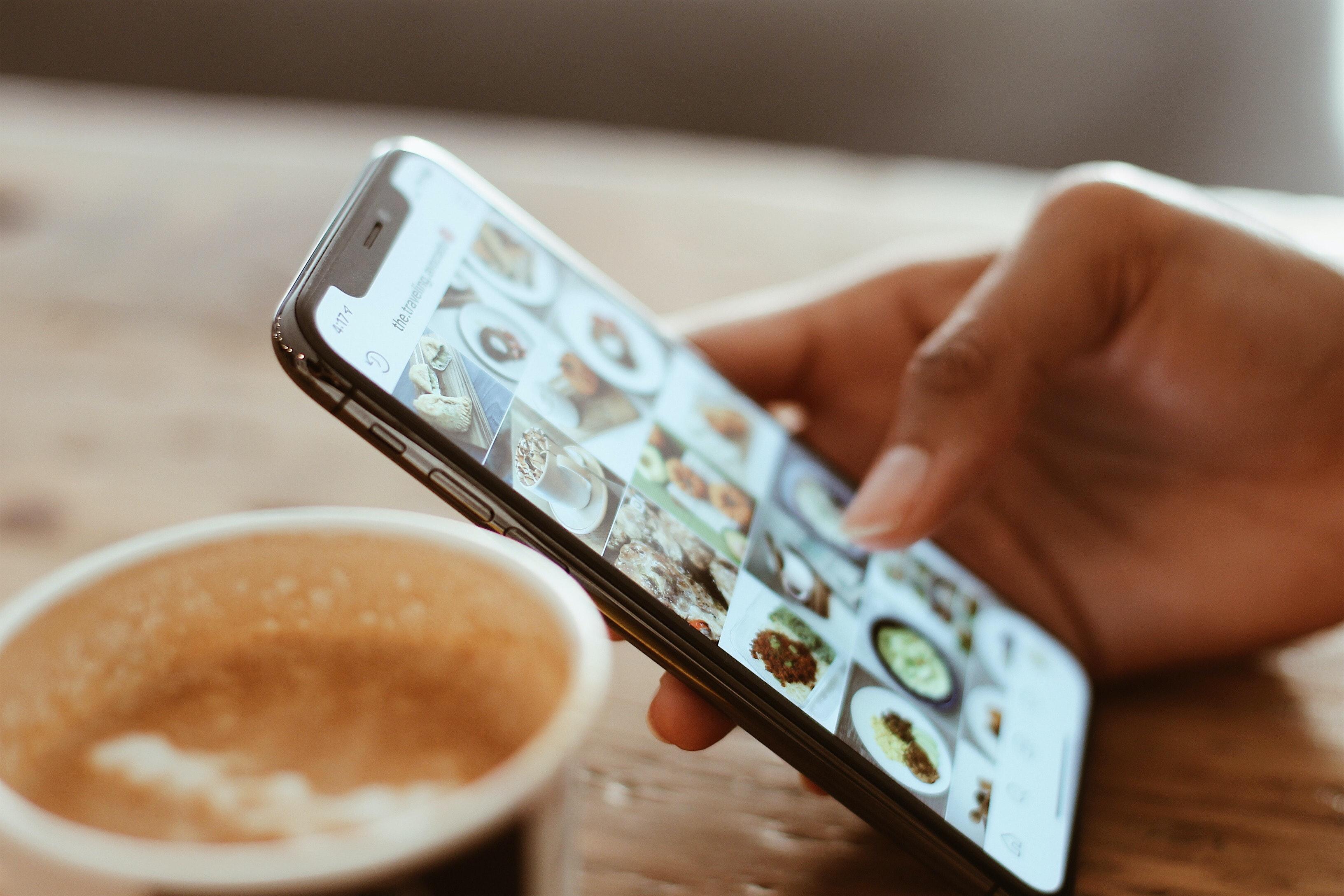 Person looking at Instagram on phone (Pic: Kerde Severin/Pexels)