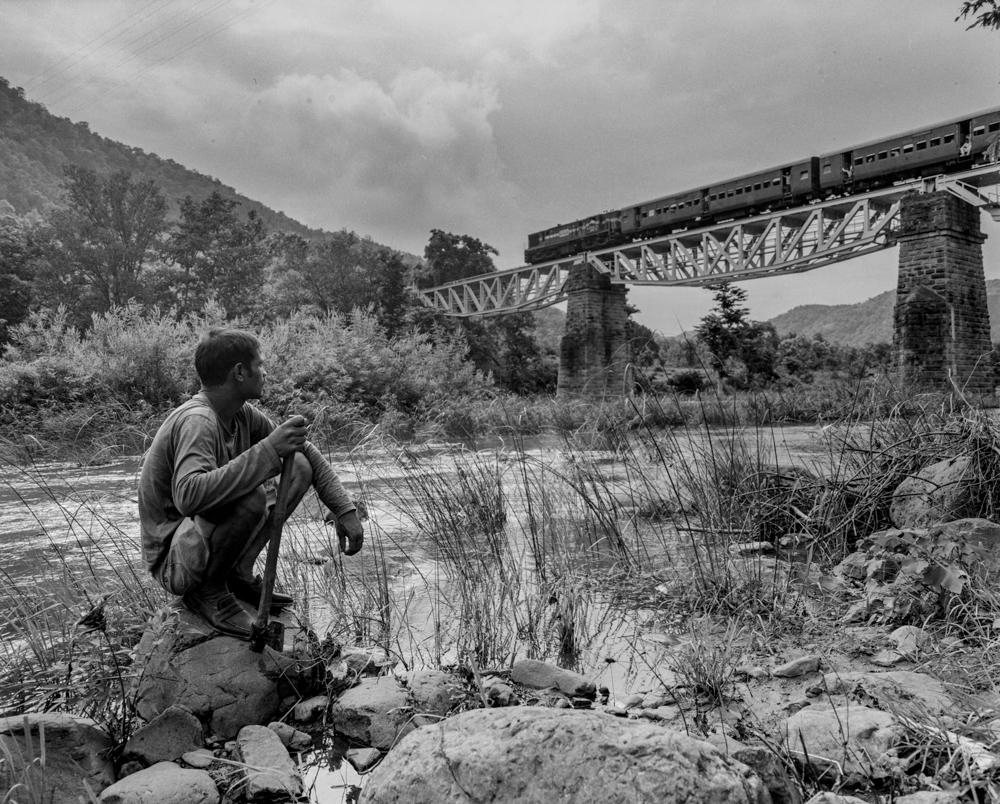 Man watching train pass (Pic: Nandakumar Narasimhan)