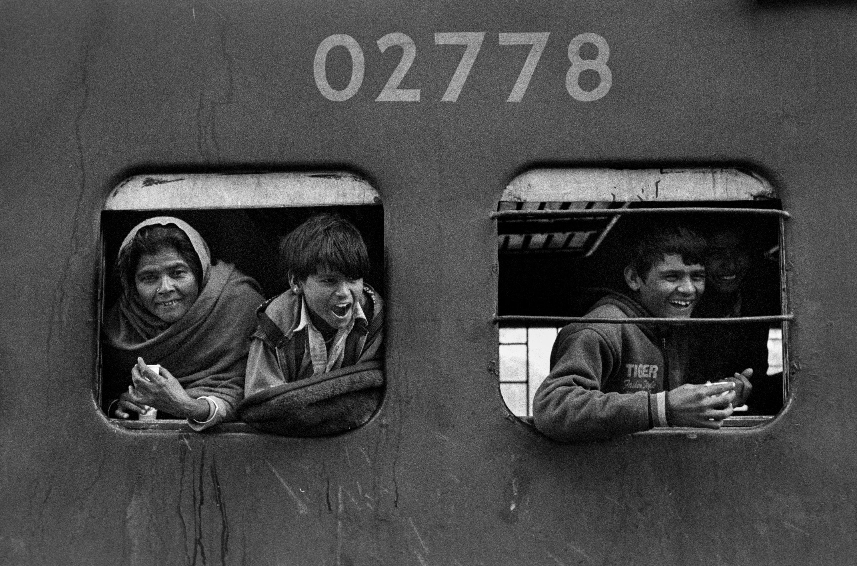 People leaning out of train (Pic: Nandakumar Narasimhan)
