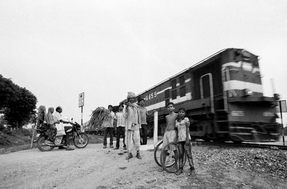 Train and people at level crossing (Pic: Nandakumar Narasimhan)