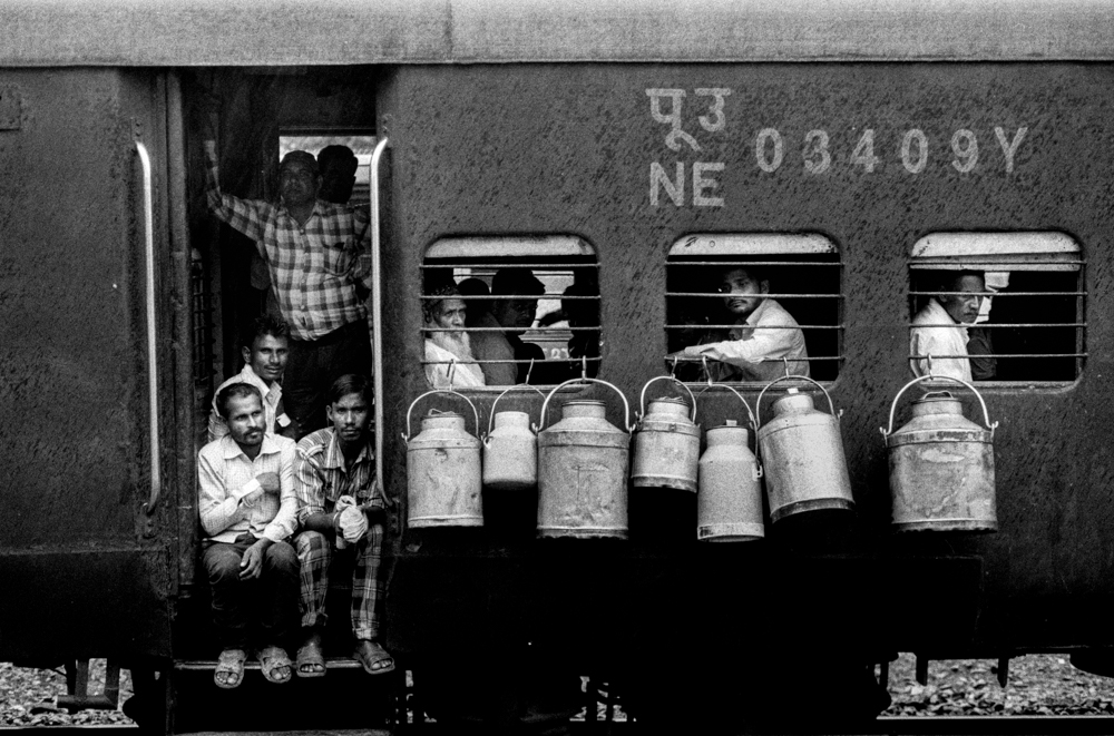 Milk cans hanging on train (Pic: Nandakumar Narasimhan)