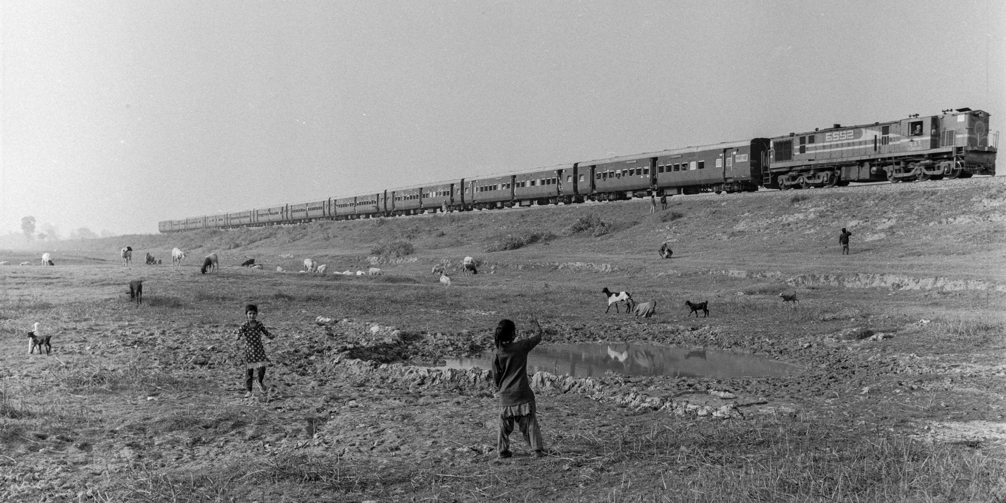 Child waving at train