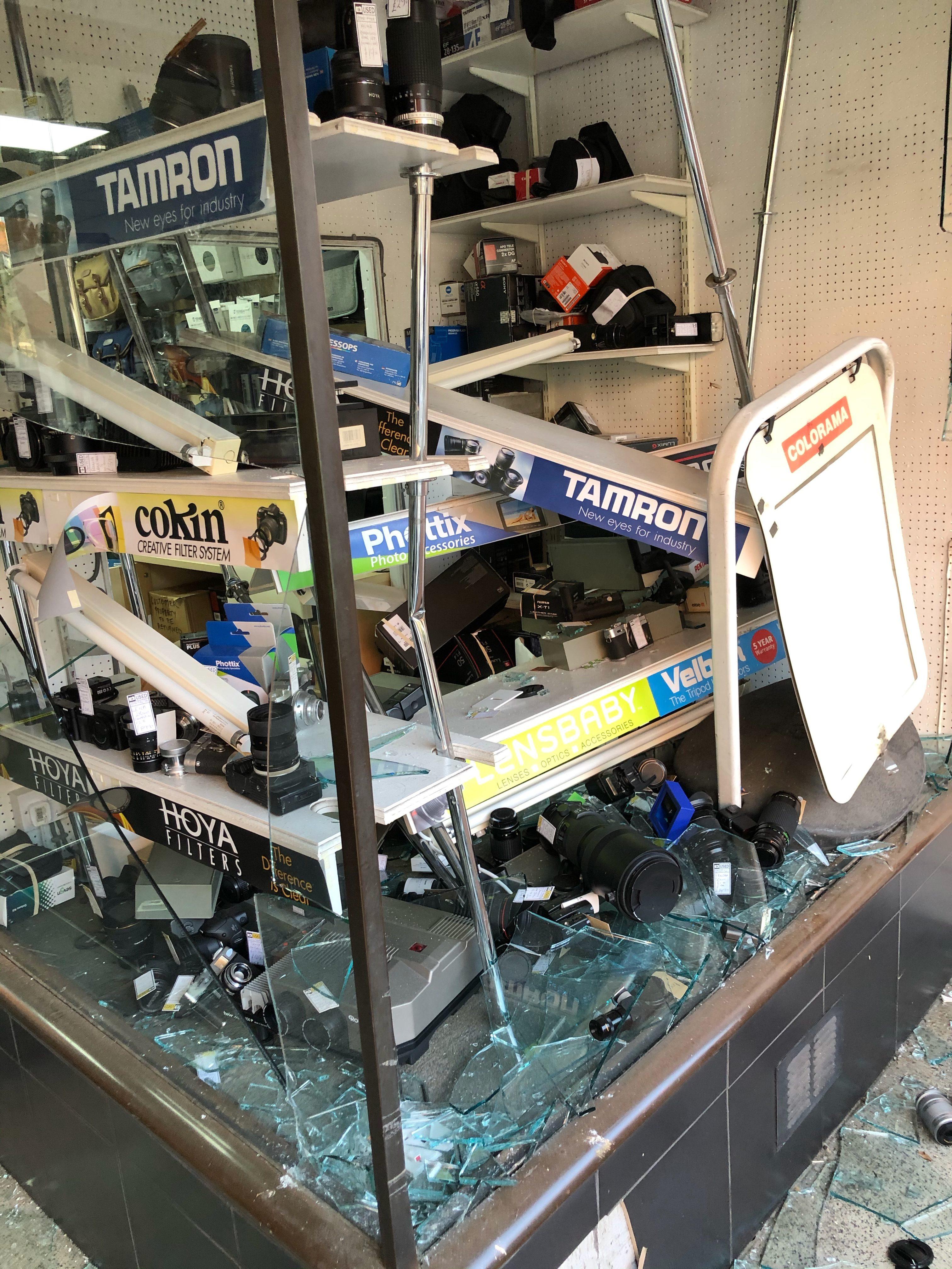 Damaged camera shop shelves (Pic: Andy Sands)
