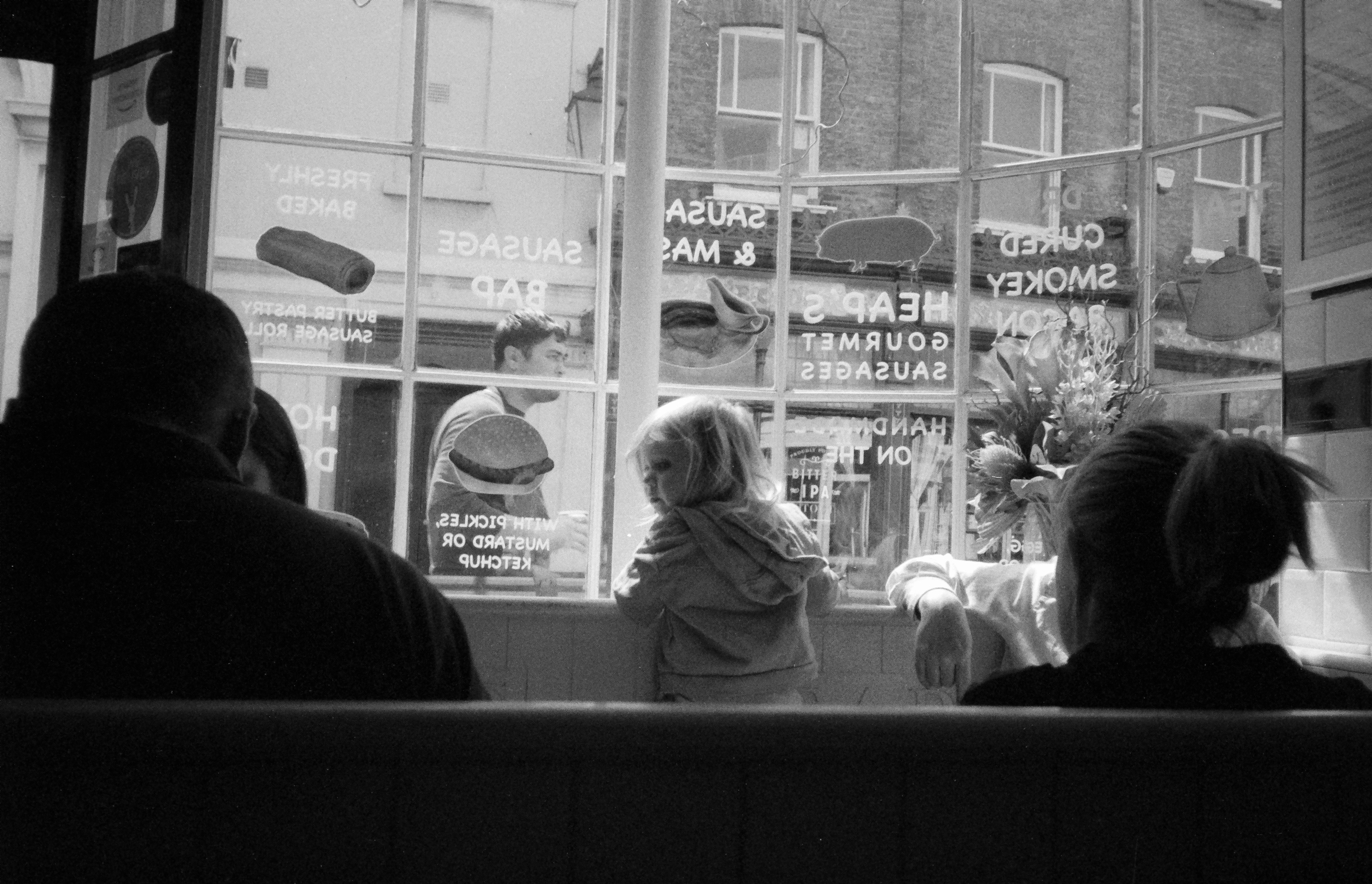 Child in cafe window (Pic: Stephen Dowling)