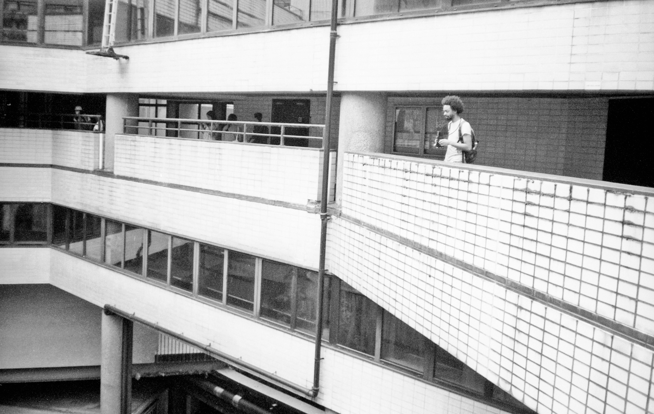 Photographer on Barbican balcony (Pic: Stephen Dowling)