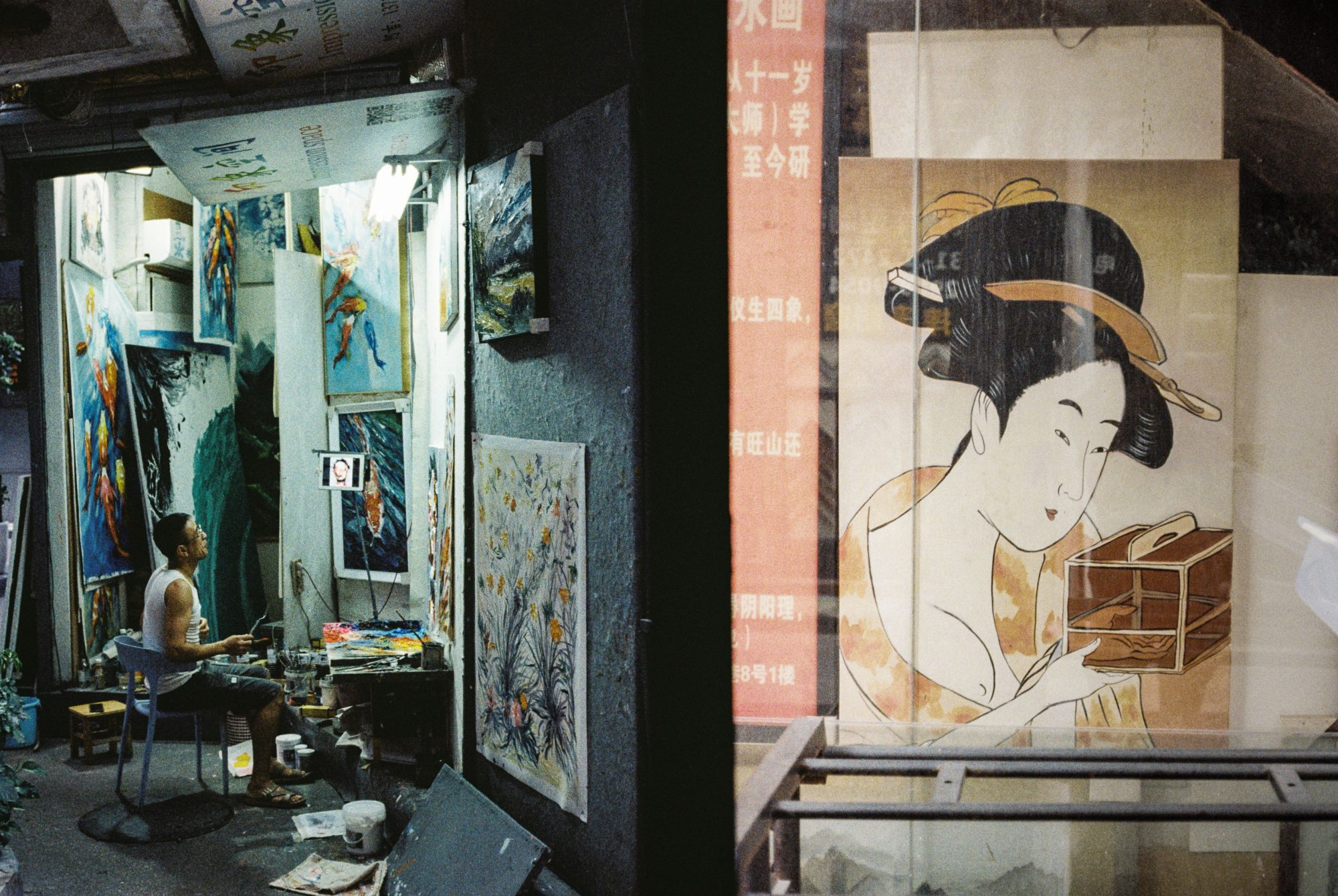 Artist painting and traditional print of woman (Pic: Jay SE1)