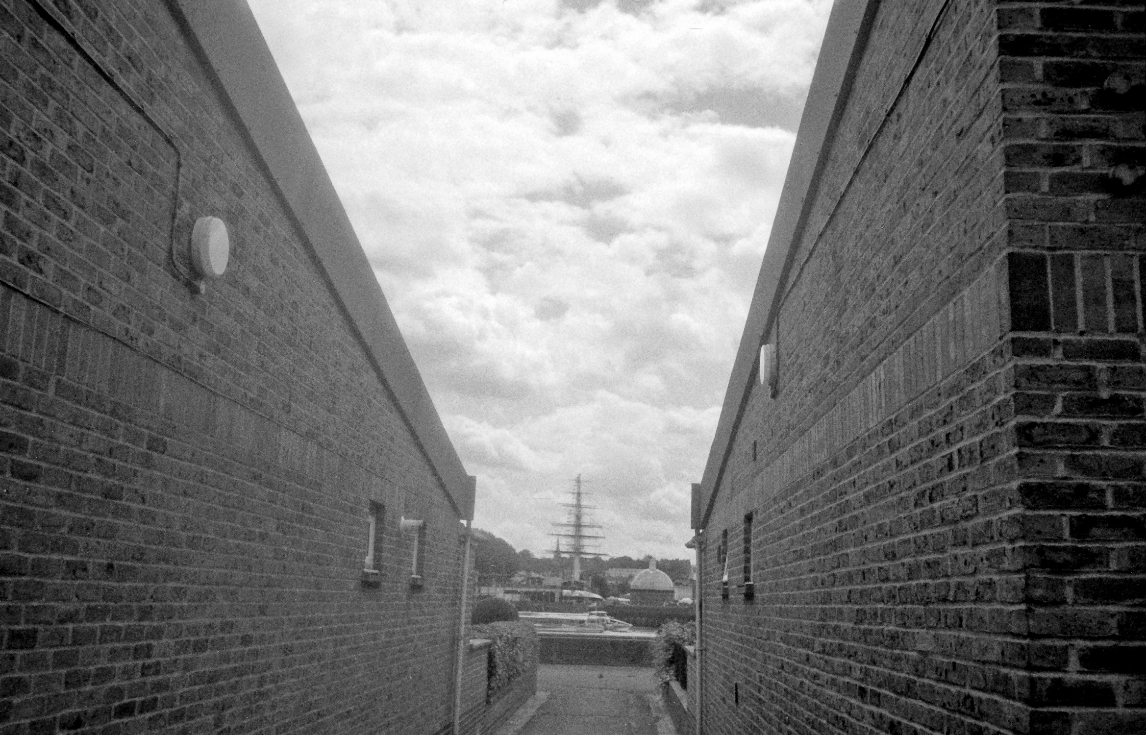 Ship mast between two brick buildings (Pic: Stephen Dowling)